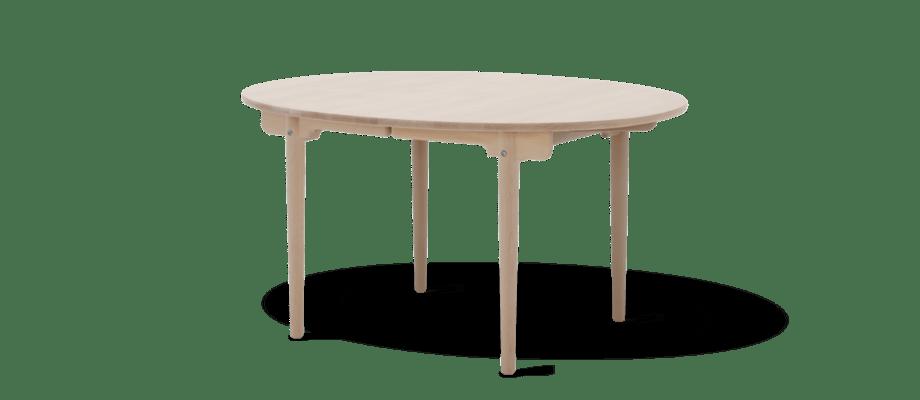 Carl Hansen CH337 Runt matbord med iläggsskiva i såpad ek av Hans J Wegner
