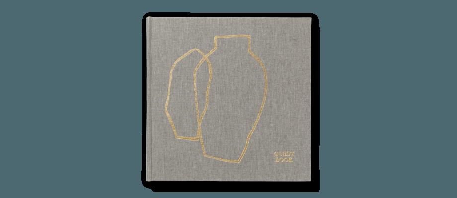 Ferm Living Guest Book Gästbok i grått canvastyg med guldfärgade detaljer