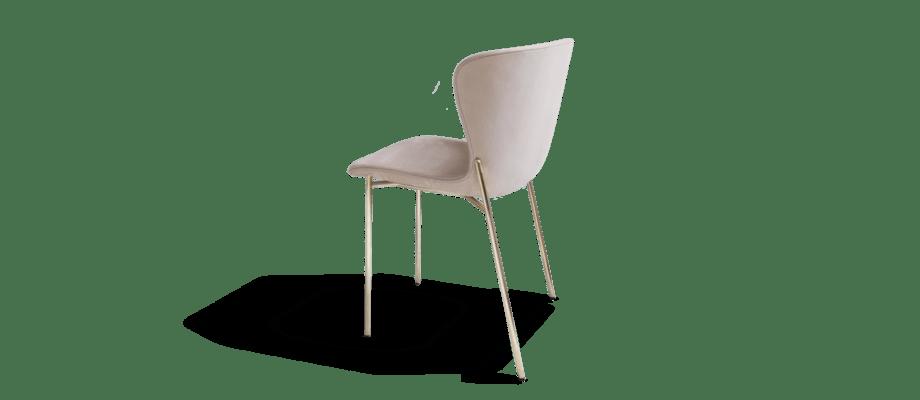 La Pipe är en elegant stol i sammet i tyget Velvet med ben i mässing