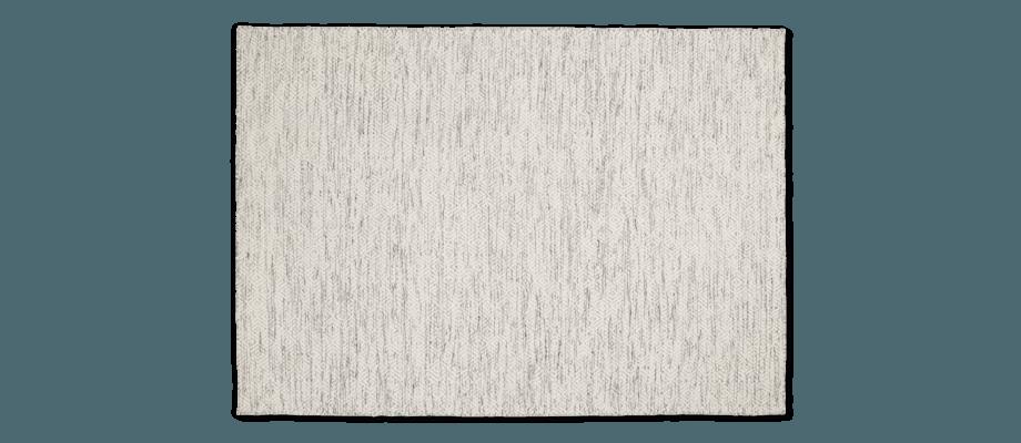 Linie Design Nyoko Ullmatta i vit färg med gåsögemönster och inslag av svarta toner