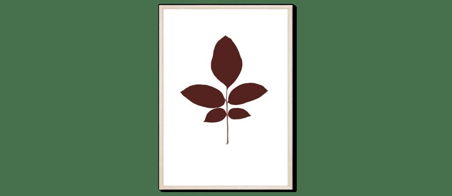 Magis Leaves Walnut Print med bruna blad och en ljus ram av ask